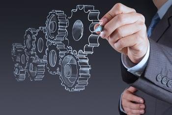businessman hand draws gear to success concept-1